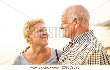 Happy Senior Retired Couple Having Fun Outdoors At Travel Vacation - Love Concept Of Joyful Elderly