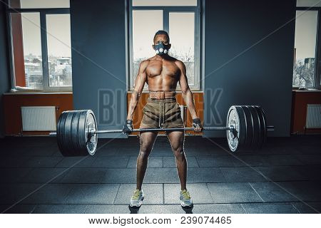 African American Athletic Man In Sport Mask Doing Deadlift With Heavy Barbell. Black Man Lifting Bar