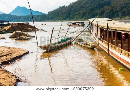Boats Near The Bank Of The River Nam Khan In Luang Prabang, Laos. Copy Space For Text.