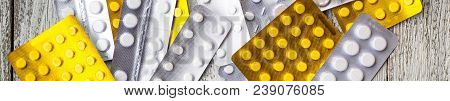 Banner Of Medicine Pills In Packs. Pills In Blister Pack, Capsules And Pill Packed In Blisters On Wh