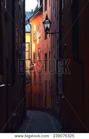 The Narrow Alley With Old Cobble Street In Gamla Stan, Stockholm, Sweden