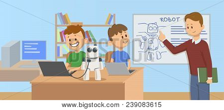 Happy Kids In Classroom Studying Robotics, Science. Teacher Explaining Robot Mechanics To The Studen