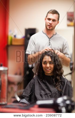 Portrait of a hairdresser talking with a customer