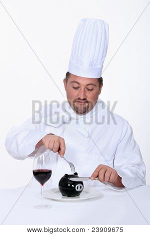 Chef cutting into his savings