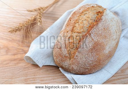 Loaf Of Bread On Wooden Background, Close-up View