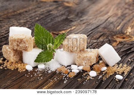 Various Types Of Sugar - Brown, White, Crystal, Cane  And Artificial Sweetener On Nwooden Table.