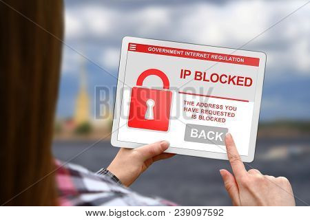 Ip Address Blocked Concept, Girl Holds The Digital Tablet On Blurred Clouds Background
