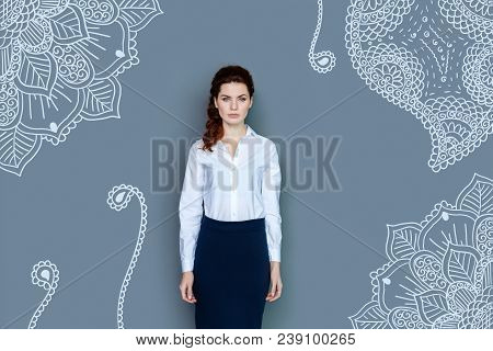 Cold Glance. Young Serious Business Woman With Curly Hair Wearing Formal Clothes While Looking At Yo