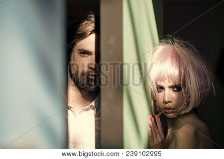Couple Of Woman And Man Separated By Green Blue Wall. Girl Wear Pink Wig And Macho With Beard. Crisi
