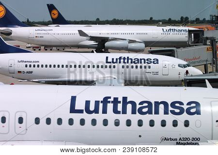 Dusseldorf, Germany - July 8, 2013: Multiple Lufthansa Aircraft Wait In Dusseldorf Airport, Germany.