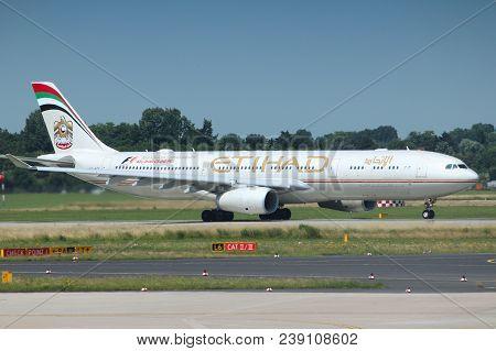 Dusseldorf, Germany - July 8, 2013: Airbus A330 Of Etihad Airways In Dusseldorf Airport, Germany. Et