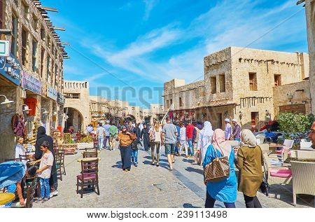 Doha, Qatar - February 13, 2018: Noisy And Crowded Shopping Street Of Souq Waqif, Tourists And Local