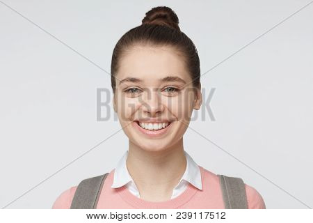Indoor Headshot Of Young Good-looking European Caucasian Girl Isolated On Gray Background Wearing Ha