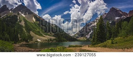 Panorama Of Pyramid Peak (left), Maroon Bells (right), And Crater Lake In Snowmass Wilderness In Asp