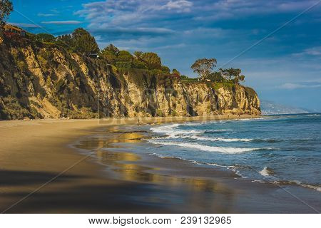 Beachside View Of Beautiful Blue Pacific Ocean And Stunning Cliffs Surrounding Dume Cove On A Sunny