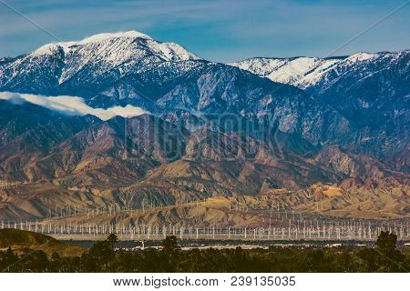 Beautiful snow-covered Mount San Jacinto rises above the Coachella Valley and San Gorgonio Pass Wind Farm, Palm Desert, California poster