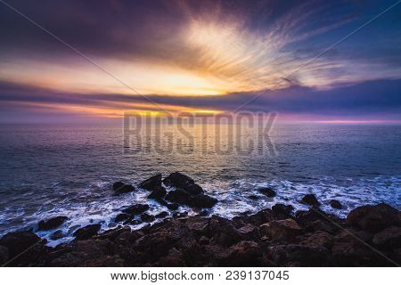 Stunning Sky After Sunset Along Point Dume State Beach With Waves Crashing Into Rock Formations Alon