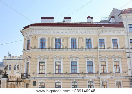 Classical Building Facade Architecture Of Old Historic House With Pale Beige Colored Walls. Exterior