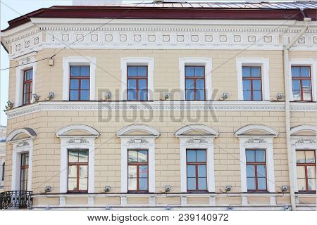 Classic Architecture Building Facade Of Old Historical House With Soft Beige Colored Walls. Exterior