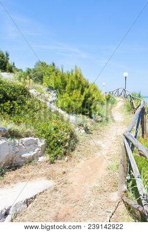 Lido Cala Lunga, Apulia, Italy - Hiking Trail At The Coastline Of The Mediterranean Sea