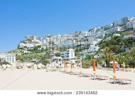 Pescichi, Apulia, Italy - Beach And City Skyline Of Pescichi