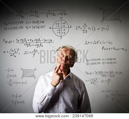 Old Man In White Is Solving Equation. Thinking.