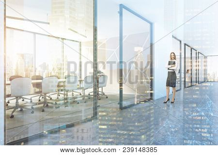 White Panoramic Boardroom Interior With A Concrete Floor, A Long Wooden Table And White Chairs As Se