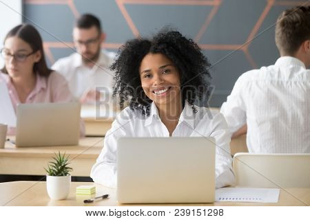 Smiling Young African Woman Employee, Office Worker Or Student Looking At Camera In Coworking, Happy