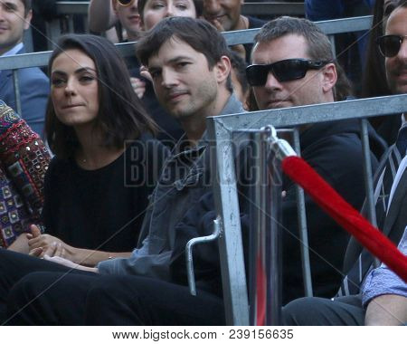 LOS ANGELES - MAY 3:  Mila Kunis, Ashton Kutcher, Sam Worthington at the Zoe Saldana Star Ceremony  on the Hollywood Walk of Fame on May 3, 2018 in Los Angeles, CA