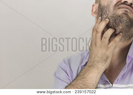 A Man Scratching His Beard On White. A Man Scratching His Beard. Closeup To Mature Man Scratching Be