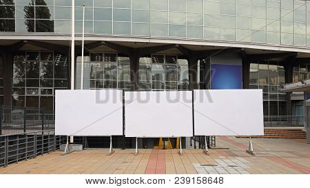 Three Empty Billboards In Front Of Expo Building