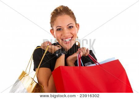 happy smiling female shopper holding shopping bags isolated