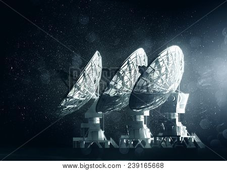 A Group Of Large Radio Telescopes At Night. 3d Illustration