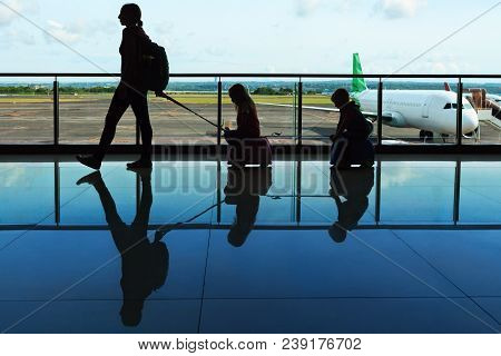 Mother With Kids Walk To Flight Boarding In Airport Transit Hall And Look Through The Window At Airp