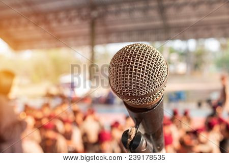 Old Microphones On Stand In Abstract Blurred Of Speech In Scout Camp, Speaking Light For Presentatio