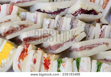 Background Of Big Sandwiches With Flat Bread  Salami And Bolied Eggs And Salad