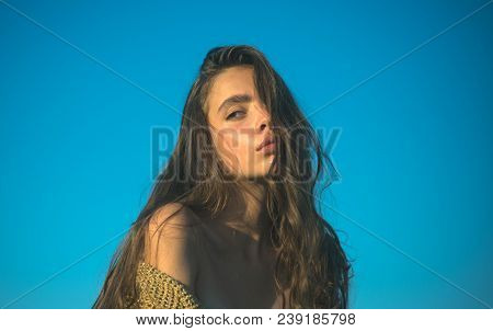 Pretty Woman With Long Hair On Blue Sky. Woman With Natural Makeup. Girl With Healthy Young Skin. Fa