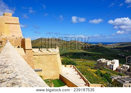 Victoria, Gozo, Malta - April 3, 2017 - Elevated View Of Fortified Buildings And The Landscaped Old