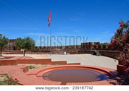 Silves, Portugal - June 10, 2017 - Courtyard And Gardens Of The Medieval Castle With Battlements And