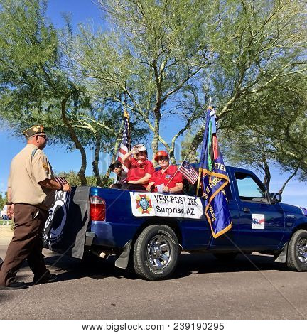 Surprise, Az- Nov. 11: Two Women Dressed In Red That Belong To Veterans Of Foreign Wars Post 285 Rid
