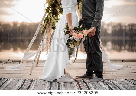 Man And His Beautiful Fiance In The Wedding Ceremony On The Beach On The Wooden Rostrum