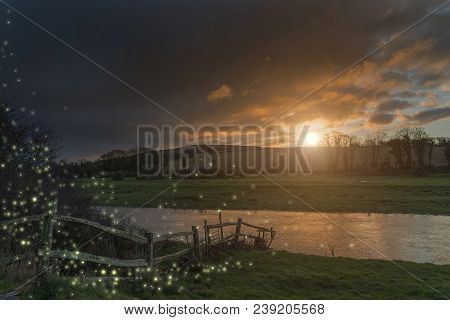 Beautiful Fantasy Image Of Fireflies At Dusk Over River Landscape Scene