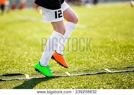 Boy Football Player On A Training With Ladder. Young Soccer Player At Training Session. Soccer Speed