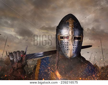 Portrait Of A Knight With Sword On Batllefield. Knight With Sword In Battlefield.