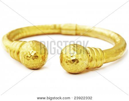 artistic hand made 22 carat gold hammered bracelet in Ottoman style with grunge texture on white background.
