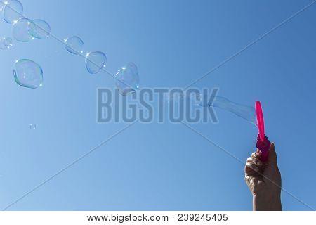 Soap Bubbles, Blowing Soap Bubble Blue Sky Background Colorful Bubble With Rainbow Reflection