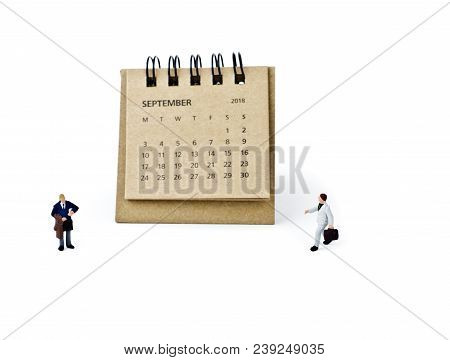 September. Meeting In September. Two Thousand Eighteen Year Calendar And Two Miniature Plastic Busin
