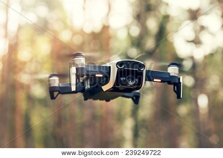 Drone Hovering In The Air In The Woods