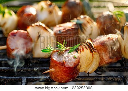 Grilled Skewers With Sausages And Onions On A Grill Plate, Outdoor, Close Up. Grilled Food, Bbq