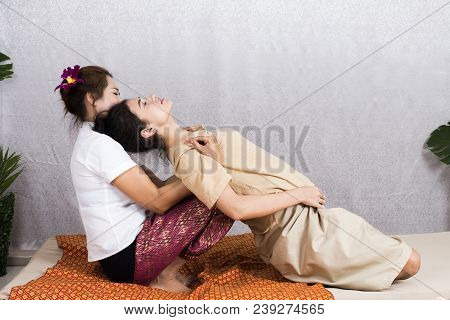 Beautiful Young Woman Having Her Body With Masseur In Spa Salon. Woman With Thai Massage. Woman With